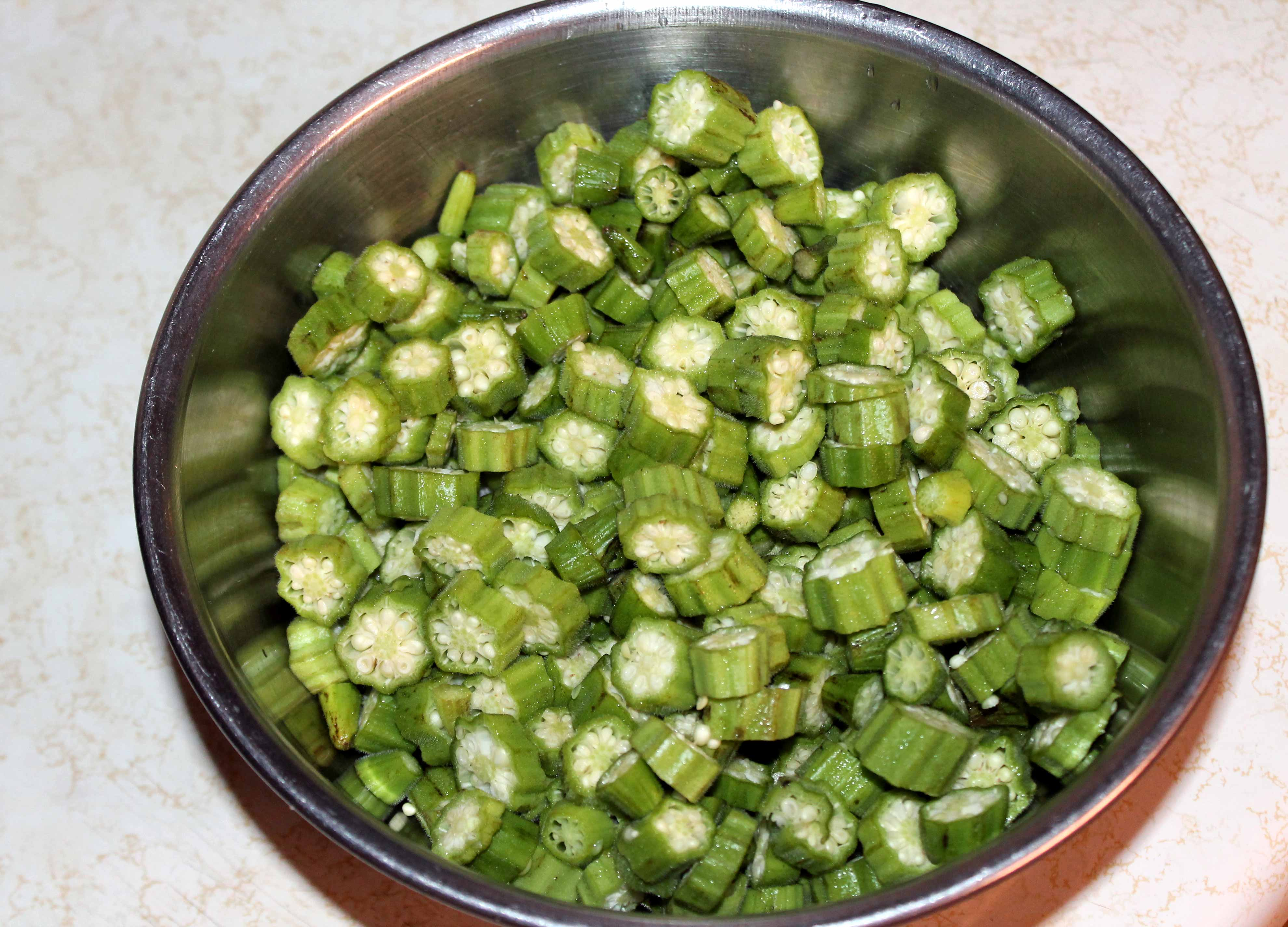 cutting the okra up is the worst part your hands get a little bit slimy but thatu0027s ok just give them a good wash and youu0027re back at it again - How To Freeze Fresh Okra